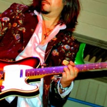guitarist rock band gig stage play color