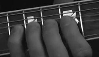 fingers on fretboard