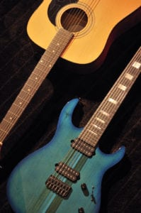 Acoustic guitar and Teal colored electric guitar