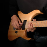 Close-up: Hands Of A Musician Playing Electric Guitar